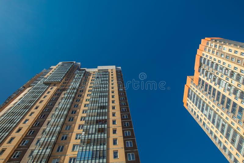 Modern building exterior. Low angle view with blue sky stock photo