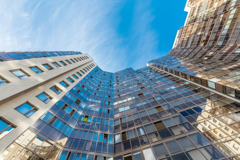 Modern building exterior. Low angle view with blue sky royalty free stock image