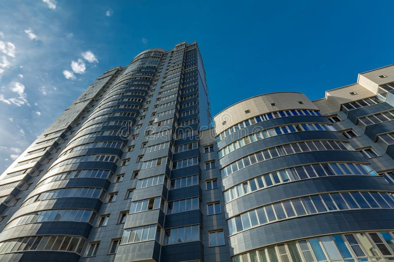 Modern building exterior. Low angle view with blue sky stock photos