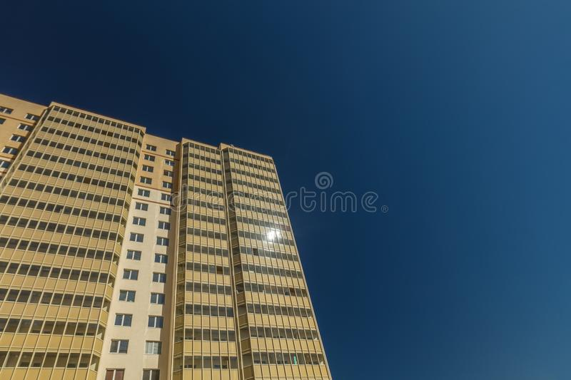 Modern building exterior. Low angle view with blue sky stock images