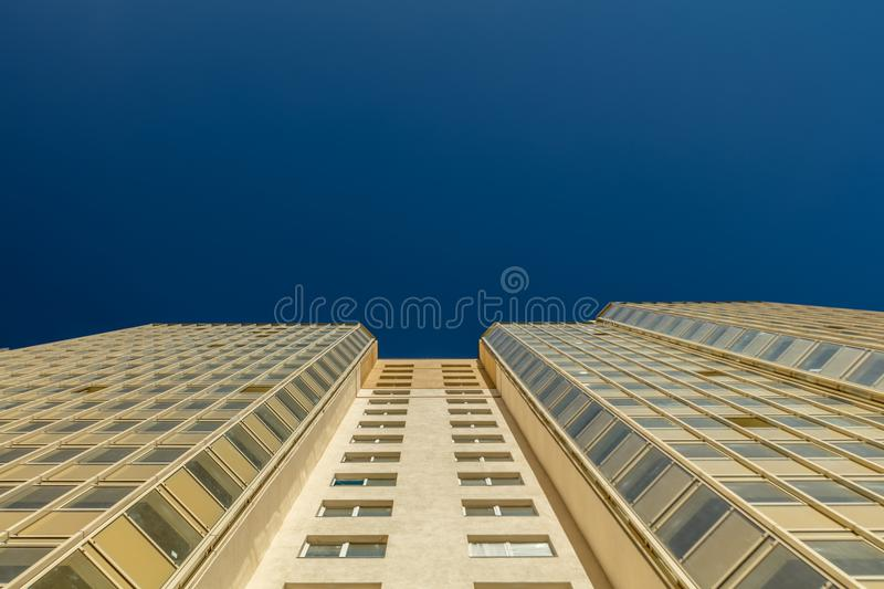 Modern building exterior. Low angle view with blue sky stock image