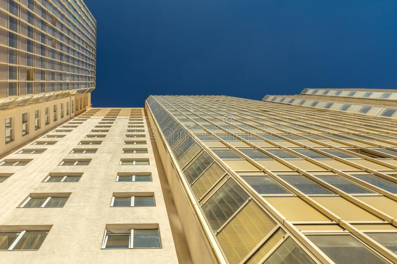 Modern building exterior. Low angle view with blue sky royalty free stock photos