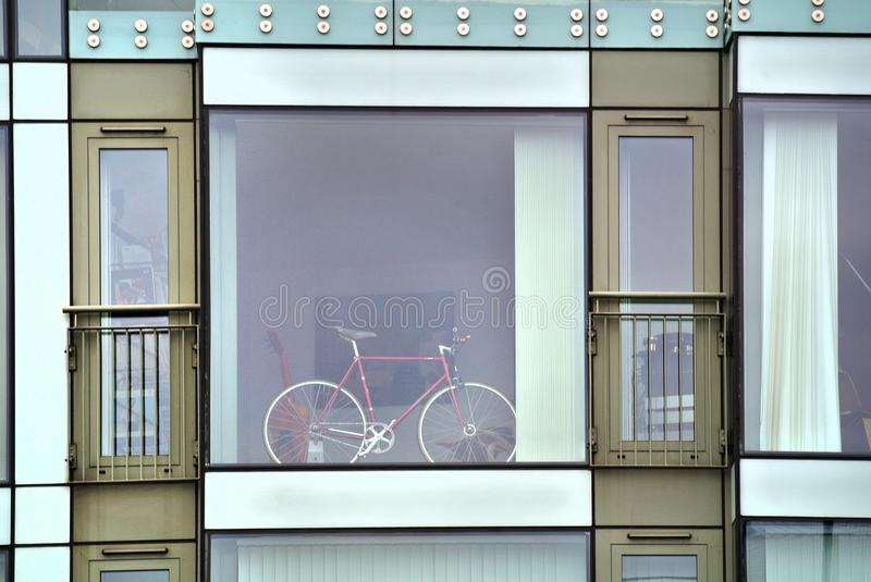 Modern building facade with big window and a bicycle, royalty free stock photos