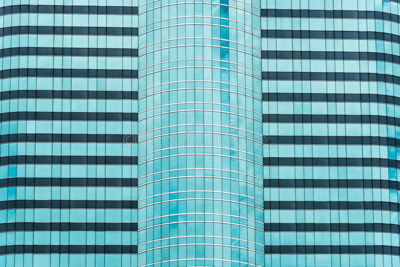 Modern Building Facade with Reflection of Clouds and Sky.  royalty free stock photography