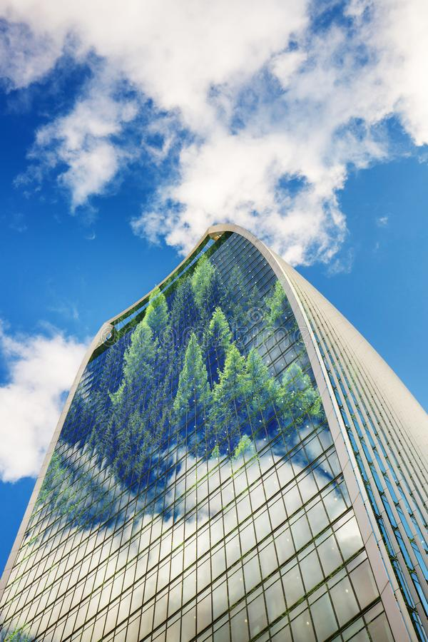 Modern building with forest and trees growing from windows and facade. Sustainable, green energy city concept royalty free stock photo