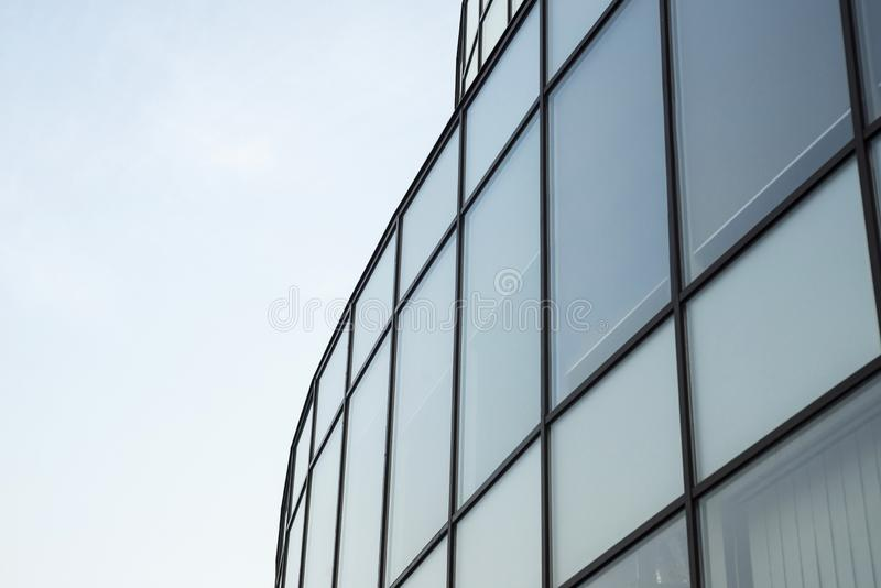 Modern building glass wall. Urban abstract background, detail of modern glass facade, office business building stock photography