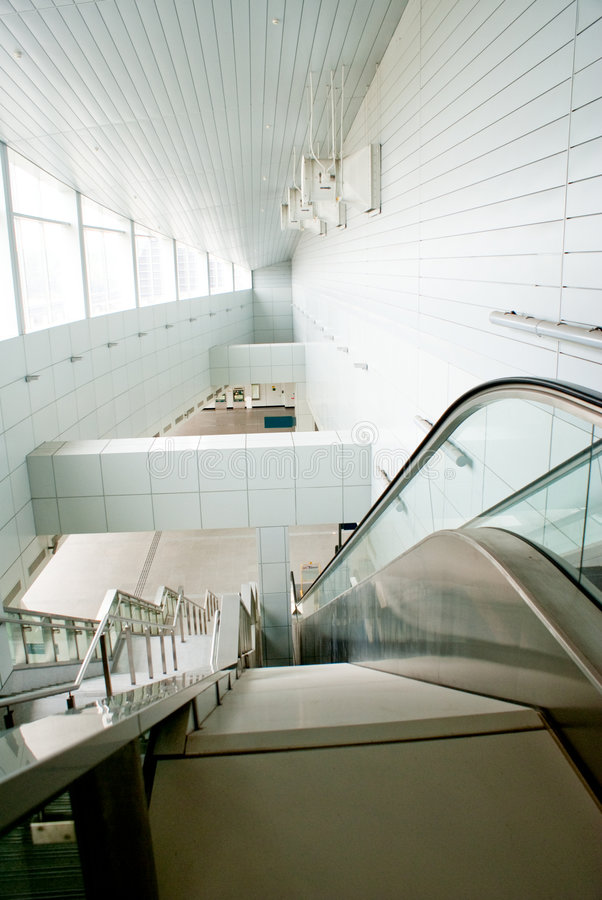 Modern building interior with escalator stock photography