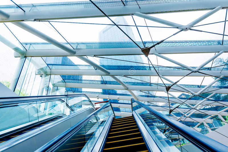 Modern building interior and escalators stock images