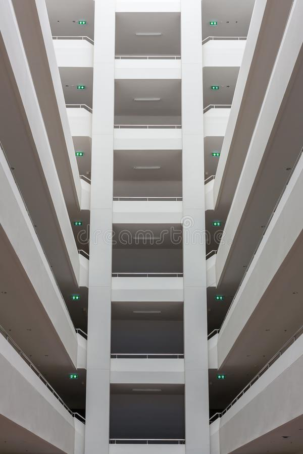Modern building layers of floor structure. Abstract Tunnel corridor stack building with symmetry layer . Low angle view from the atrium of a high-rise royalty free stock photos