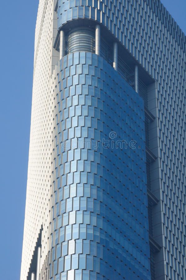 Modern Building Nanjing China. An abstract image of the glass windows outside of the Zifeng Tower in Nanjing China located in Jiangsu province stock photo