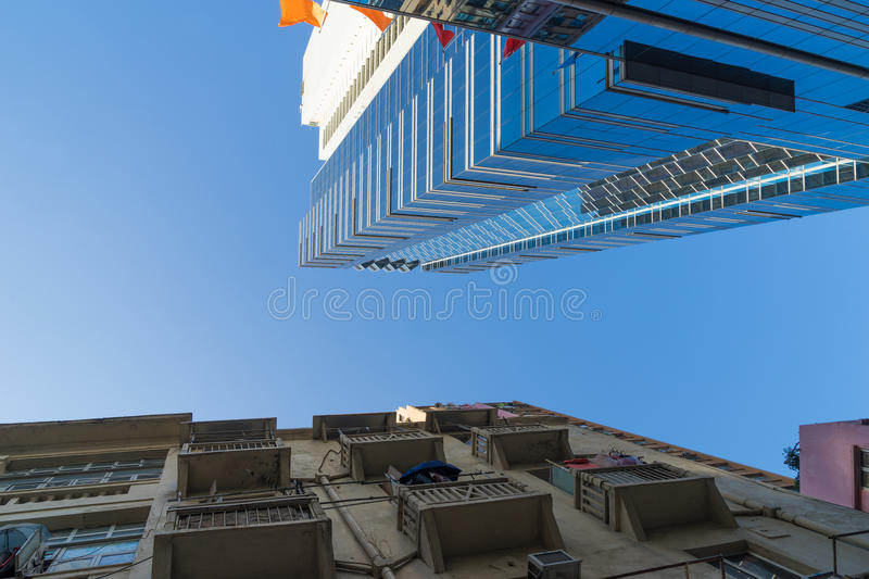 Modern building and old apartment in Hong Kong royalty free stock photo