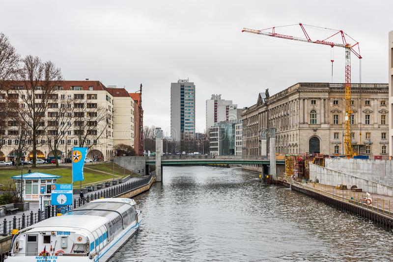 Modern building and old building at the the bank of the Spree River, in the downtown of Berlin, Germany royalty free stock image