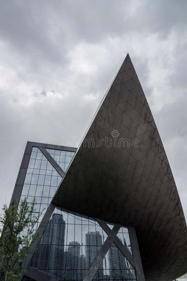 Modern building with overcast sky. Closeup of a modern building with overcast sky in china royalty free stock images