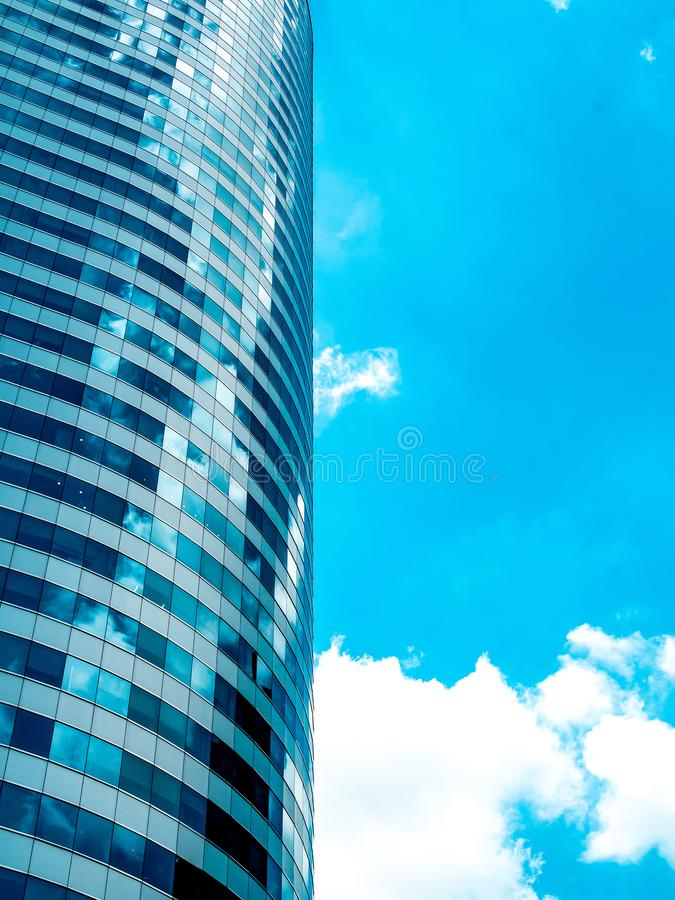 Modern building, skyscrapers reflection blue sky and clouds. Abstract technology background stock photos