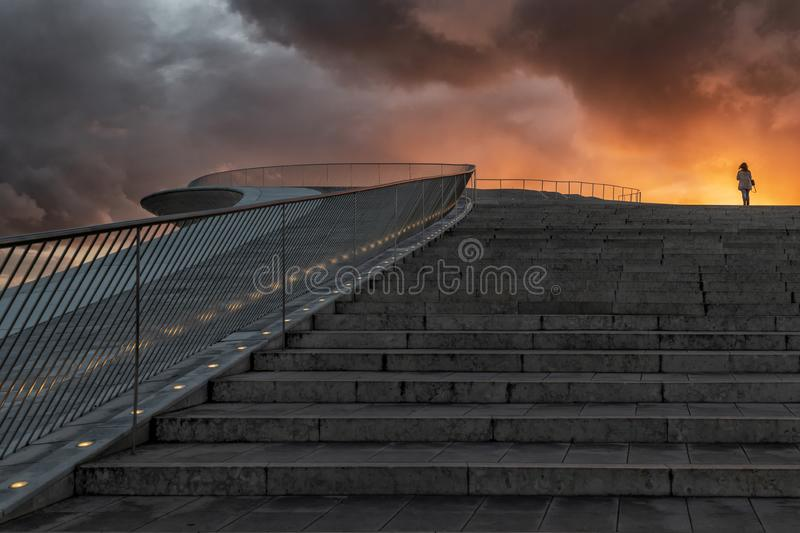 Modern building stairs on the downtown of Lisbon. With flashy sunset and silhouette of woman on top. Portugal. Lisbon stock image
