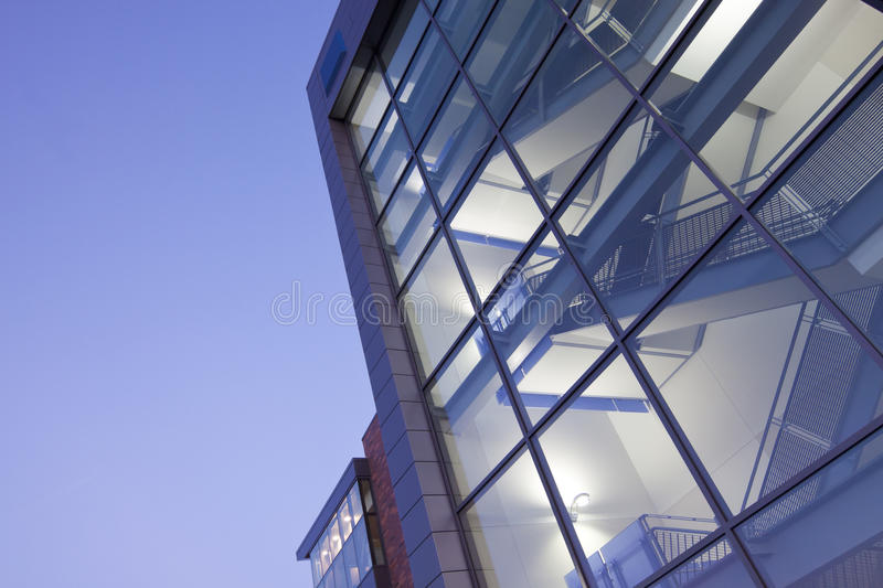 Modern Building Stairway. Seen through glass front windows royalty free stock photography