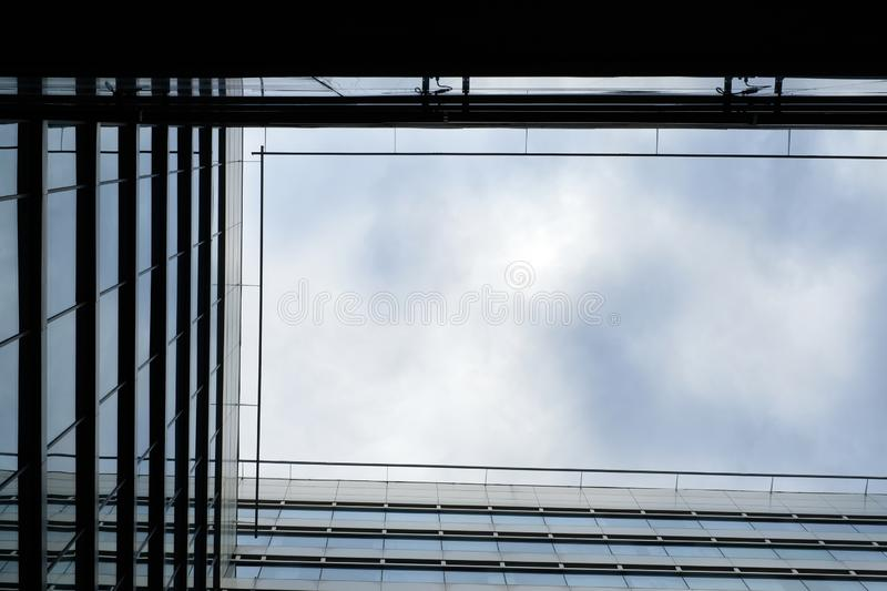 Modern building tops  against the sky. Low angle contrast framed shot of modern building tops  against the sky royalty free stock photos