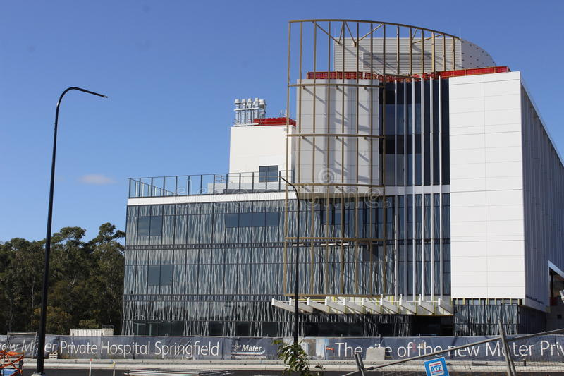 Modern building under construction. Day Oncology Centre entrance of Mater Springfield Private Hospital, Brisbane as it nears completion royalty free stock images