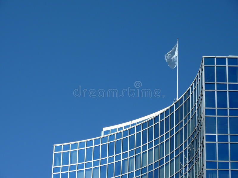 Modern building with United Nations flag royalty free stock photo