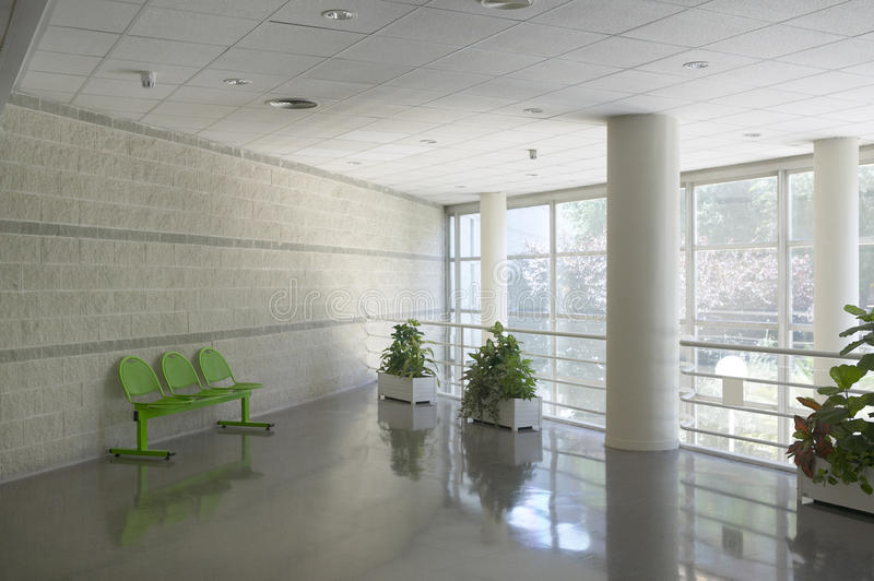 Modern building waiting area with metallic chairs. And natural light stock images