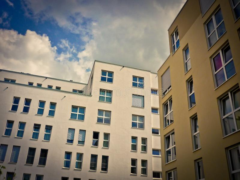 Modern buildings against clouds royalty free stock photography