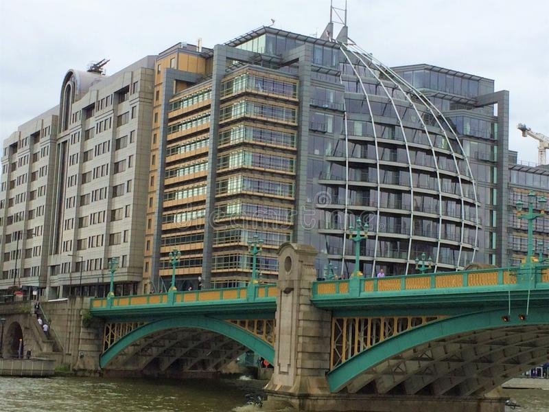 Modern buildings on the banks of Thames river. Modern office buildings on the banks of Thames river by Southwark Bridge - London, UK royalty free stock photo