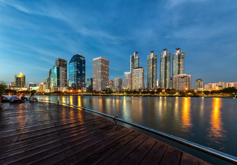 Buildings and business district cityscape from urban park,night view,cityscape image of Benchakitti Park,Bangkok,Thailand. Modern buildings and business district royalty free stock images