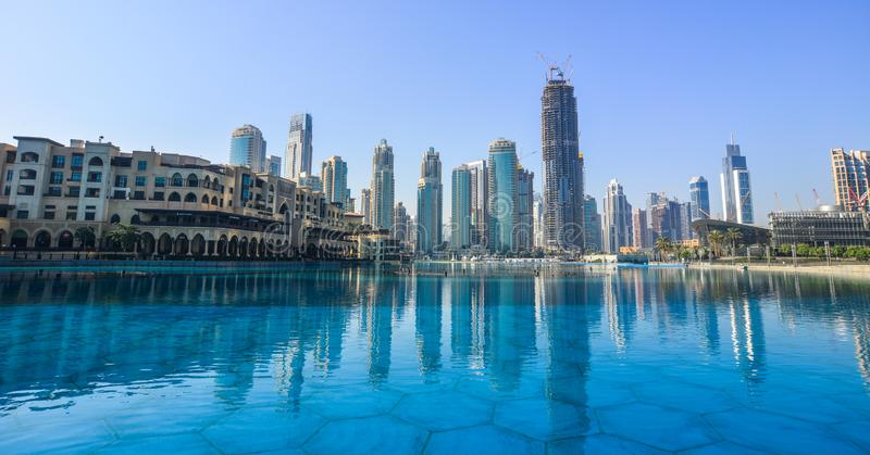 Modern buildings with the lake in sunny day royalty free stock image