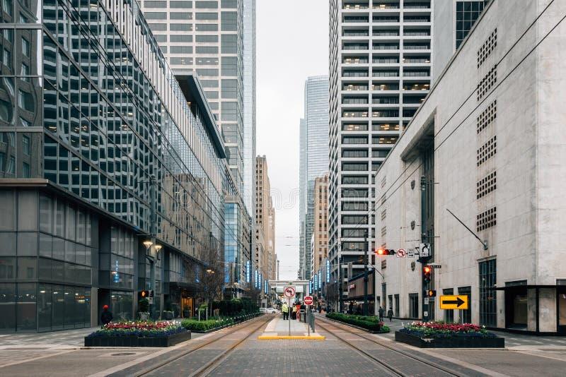 Modern buildings and light rail tracks along Main Street, in Houston, Texas stock photos