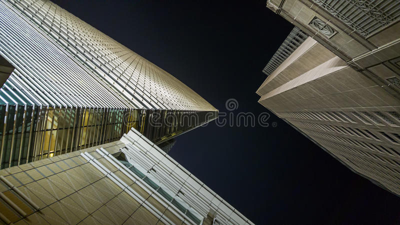 Modern buildings from low angle. At night stock images