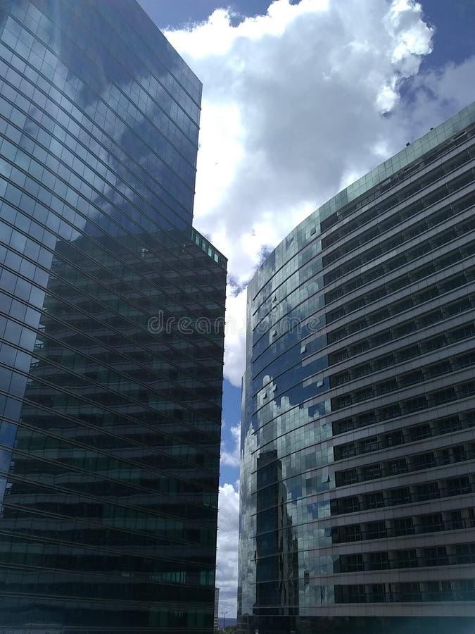 Glass buildings in Brasilia`s Hotel sector. Modern buildings with mirrored windows, in Brasilia`s hotel sector, reflecting Brasilia`s pretty sky stock photo