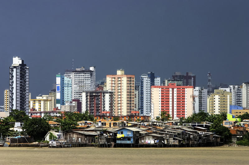 Modern buildings and palafitte slum. Modern buildings and slums on stilts on the Guama river. Belém, Brazil stock photography
