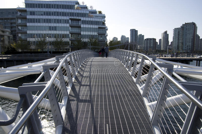 Modern buildings and pedestrian bridge Vancouver royalty free stock image