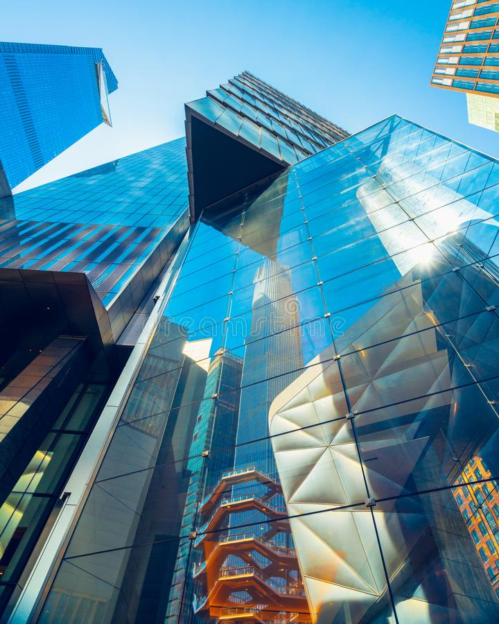 Modern Buildings Reflections, New York City, Hudson Yards. Hudson Yards, Modern Buildings Reflections against Clear Blue Sky, New York City stock images