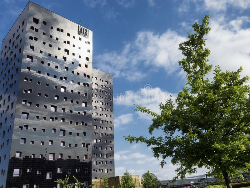 Modern buildings in Rho, Milan, Italy. Rho, Italy - June 23, 2018: Exterior of modern buildings hosting an hotel at Rho, Milan, Lombardy, Italy royalty free stock photos