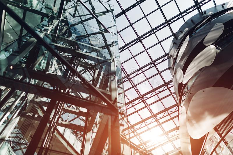 Modern buildings. Shopping center interior design details. High tech architecture. Glass and metal. Roof and elevator stock photo