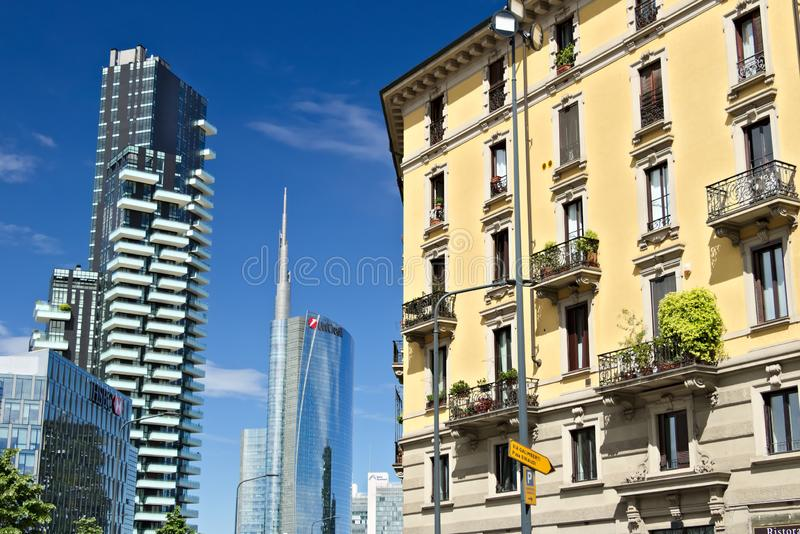 Modern buildings, skyscrapers, roads and traffic in Milano. Tower buildings, glass skyscrapers. Diamond Tower and car traffic on royalty free stock photography
