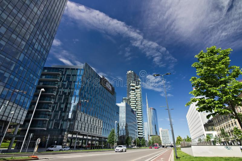 Modern buildings, skyscrapers, roads and traffic in Milano. Tower buildings, glass skyscrapers. Diamond Tower and car traffic on stock photography