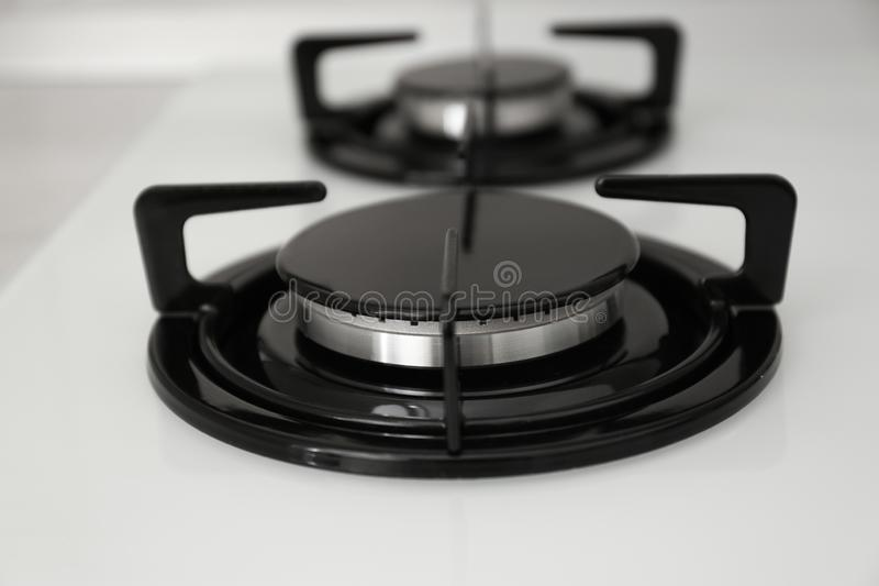 Modern built-in gas cooktop. Kitchen appliance. Modern built-in gas cooktop, closeup. Kitchen appliance stock images