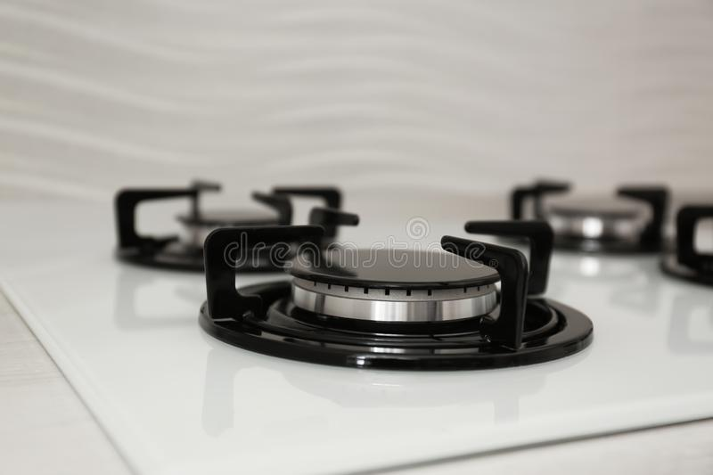 Modern built-in gas cooktop. Kitchen appliance. Modern built-in gas cooktop, closeup. Kitchen appliance royalty free stock photography
