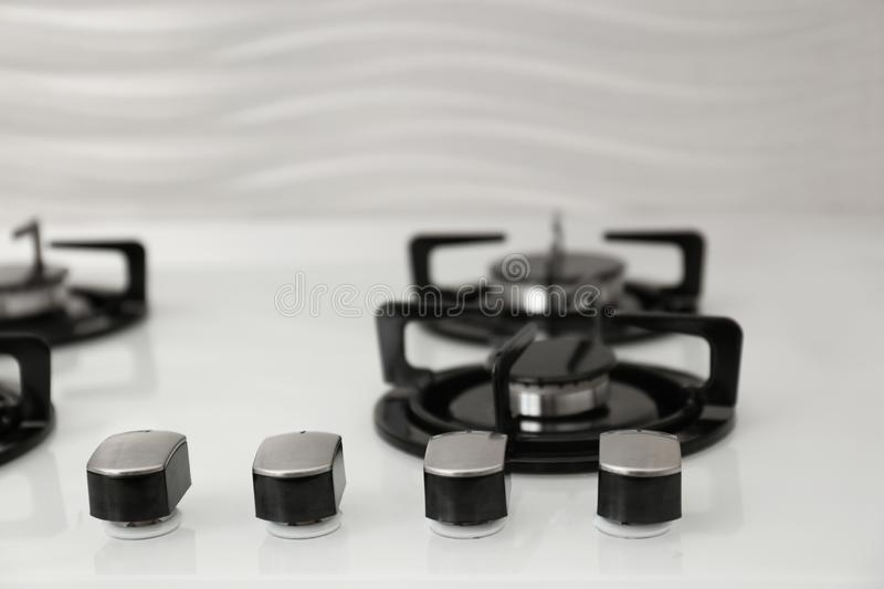Modern built-in gas cooktop. Kitchen appliance. Modern built-in gas cooktop, closeup. Kitchen appliance royalty free stock image