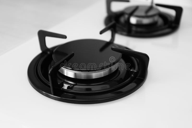 Modern built-in gas cooktop. Kitchen appliance. Modern built-in gas cooktop, closeup. Kitchen appliance royalty free stock images