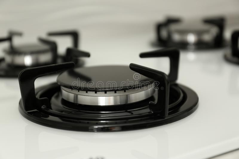 Modern built-in gas cooktop, closeup. Kitchen appliance royalty free stock photos