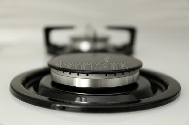 Modern built-in gas cooktop, closeup. Kitchen appliance royalty free stock images