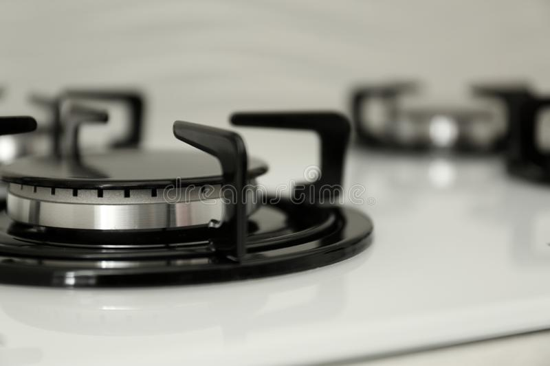 Modern built-in gas cooktop, closeup. Kitchen appliance. Modern built-in gas cooktop, closeup with space for text. Kitchen appliance stock photography