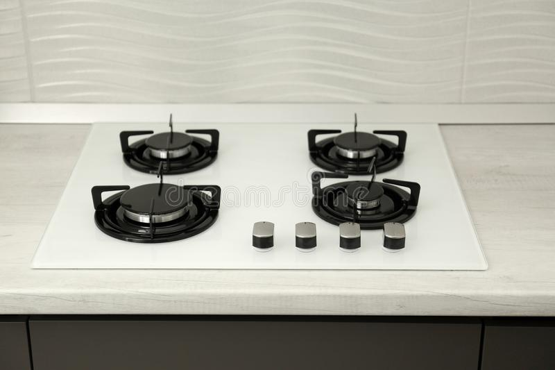 Modern built-in gas cooktop. Kitchen appliance stock photo
