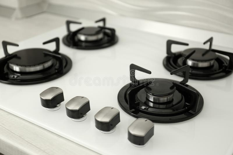 Modern built-in gas cooktop. Kitchen appliance royalty free stock photo