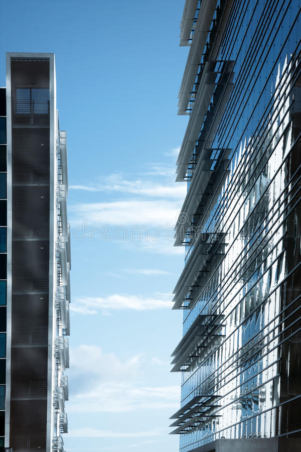 Modern business building. Against blue sky stock photos