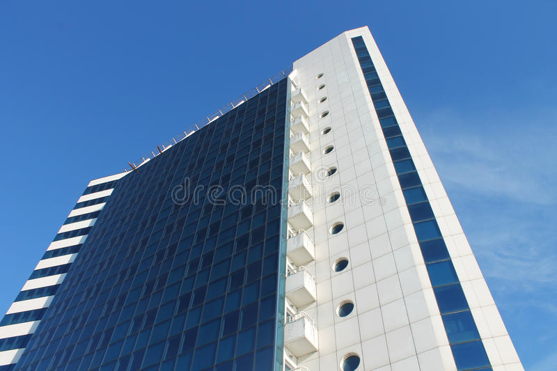 Modern business center and minimalism. Modern office building, white and blue background royalty free stock photos