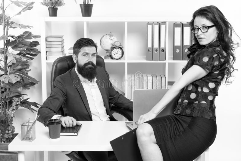 Modern business couple working in modern office. Businesspeople. Formal fashion dress code. Business couple in modern. Office. collaboration. Man with beard and royalty free stock photography